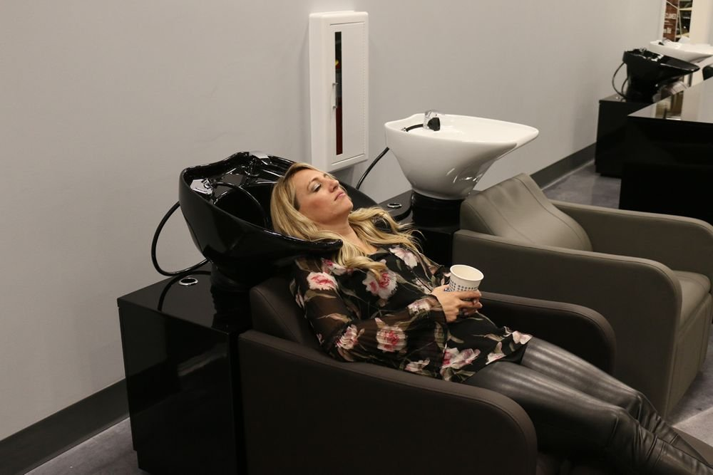 Walker enjoys her tour of Minerva Beauty's showroom where she test-drives the furnishings.
