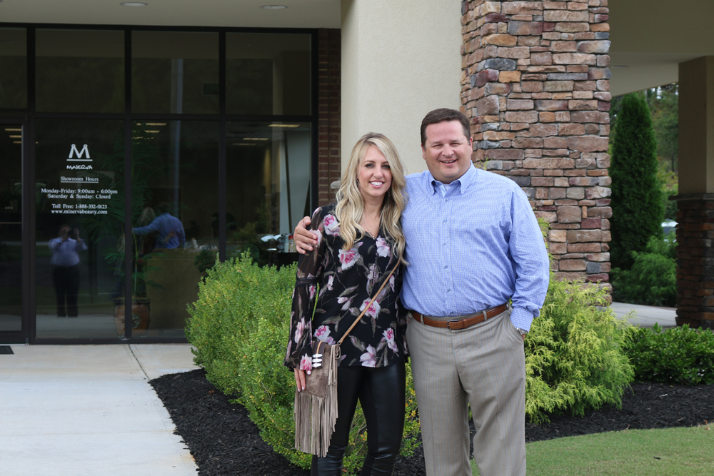 Pricilla Walker celebrates her big win with Minerva Beauty' CEO Jay Rawl during her showroom tour.