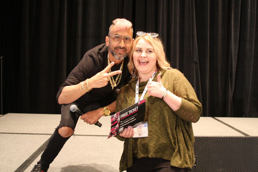 Justin Isaac poses with the winner of Redken's raffle prize, an all-expense-paid trip to Redken Symposium 2019!