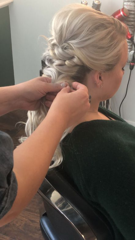 @lzhouseofhair continued to create loops and tie them with elastics. After she created a few rows, she left the rest of the hair down for a pretty, 5-minute half-up-half-down style. She later used just three bobby pins to create thes second look: a unified yet deconstructed updo that was turned under using just three bobby pins.