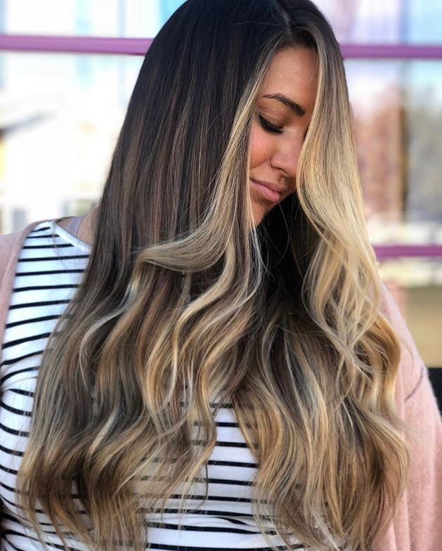 Why we love it: Love that she's looking down, just a touch of her face shows. Lengths look healthy and show off internal lightening.