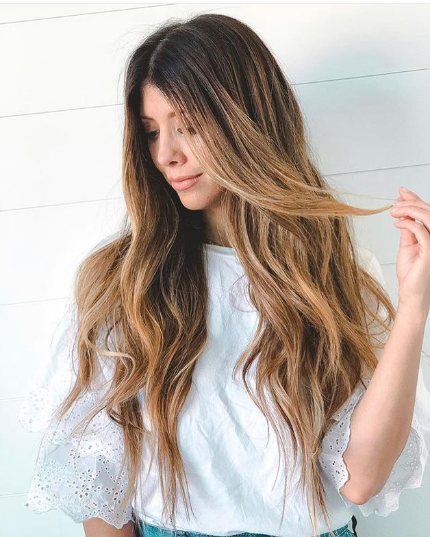 Why we love it: The playful touch of the hand in the hair.