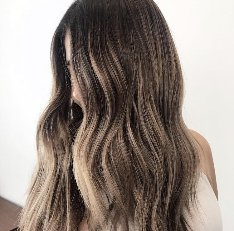 Why we love it: The face is concealed, the inside brightness is popping, and she gives great technique in her caption: While the hair is damp and you're processing a root smudge, brighten those ends!