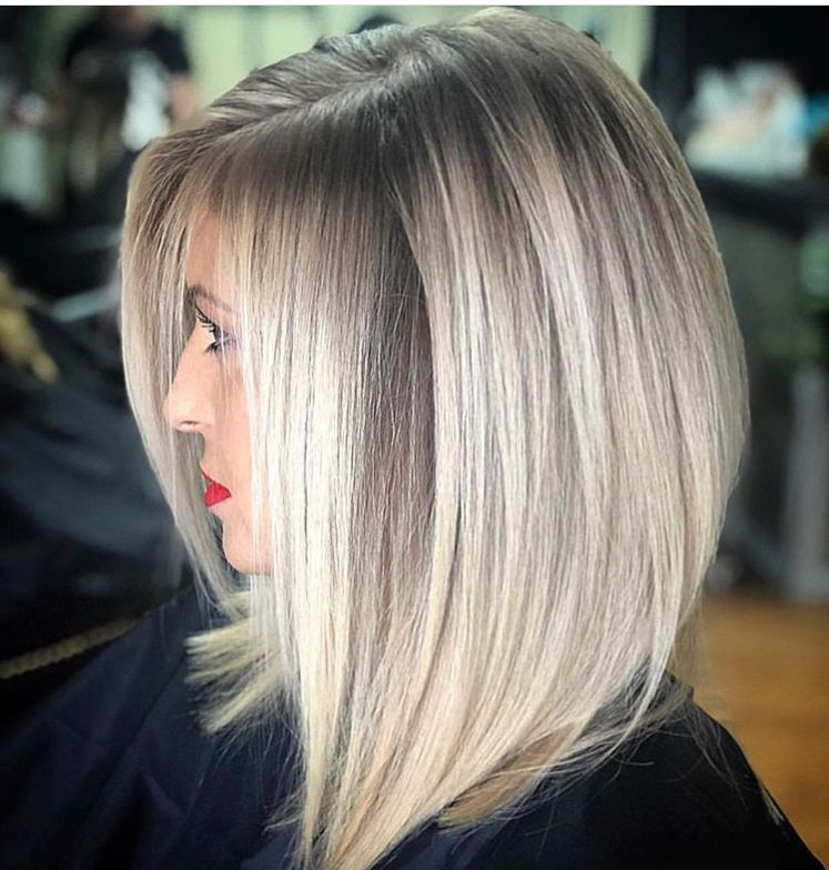 The fiercest lob we've seen in a long time, created by @rochellegoldenhairstylist using Truss Professional.