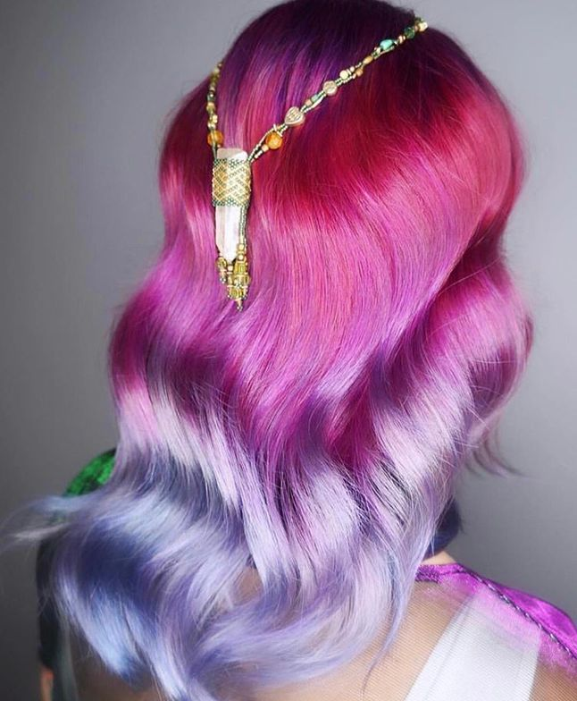In love with this color melt by @hairpaintedwithlove. After prelightening the hair to a level 10, Magenta, Purple and Turquoise Viral Colorditioner and Bondfix was applied in a melt.