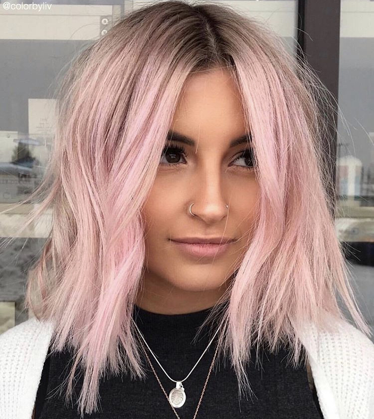 This pastel pink was created using Pastel Light Pink Viral Colorwash over @kilee_albano8's pre-lightened hair by colorist @colorbyliv.