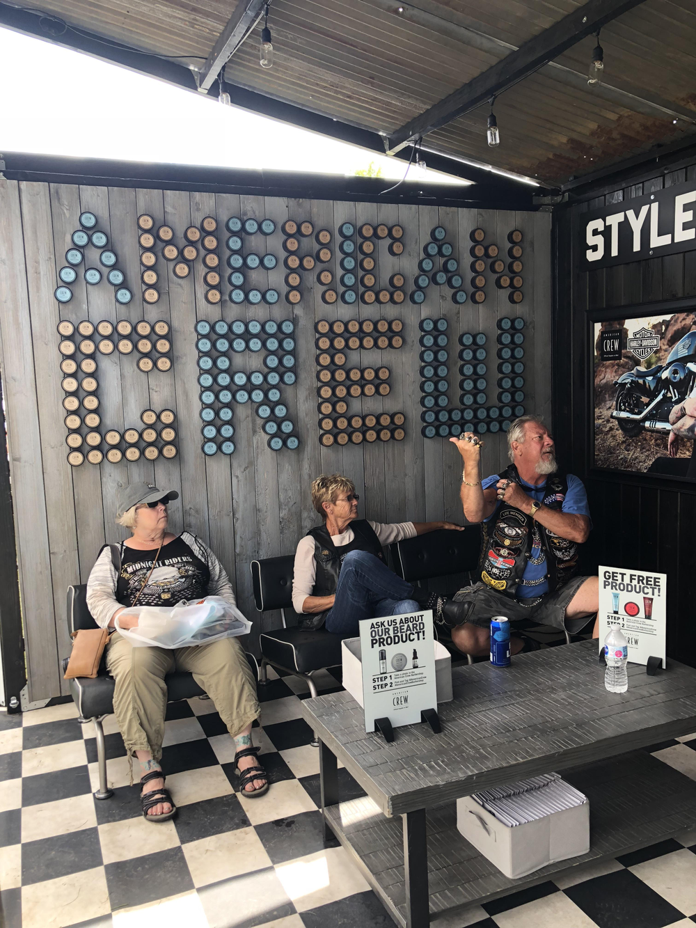 American Crew stylists provide complimentary cuts to attendees in a pop-up barbershop.