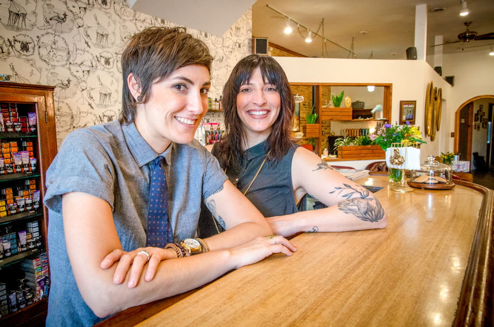 Logan Parlor co-owners Tricia Serpe and Jamie DiGrazia at the salon's bar, a key feature in building the welcoming, community environment on which the salon prides itself.