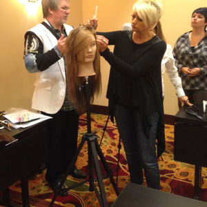 Class attendees learn from Johnny Plant how to apply the Extensions+ hair extensions.  (photo...