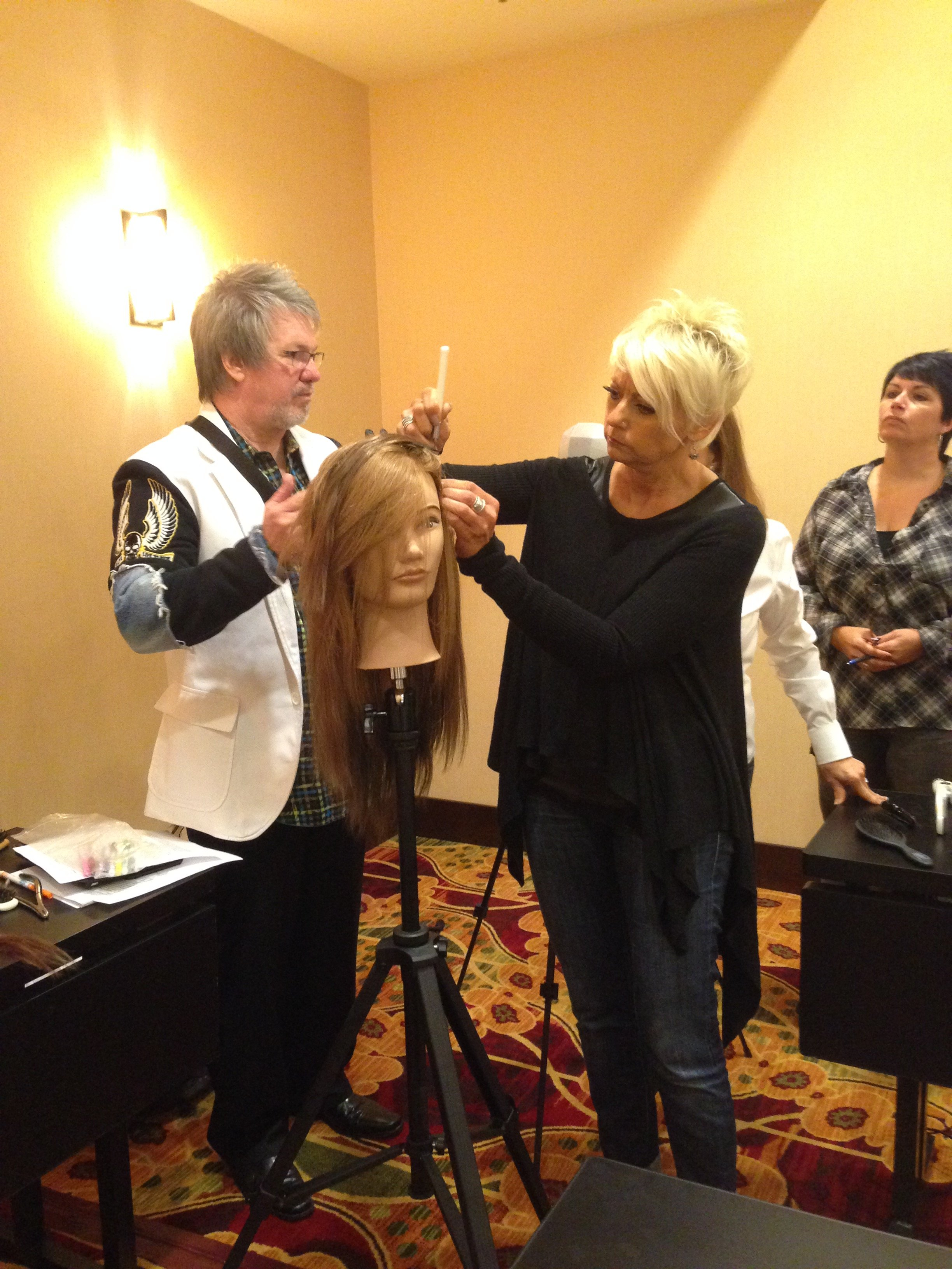 Class attendees learn from Johnny Plant how to apply the Extensions+ hair extensions.  (photo credit: Jamie Newman) Jamie Newman