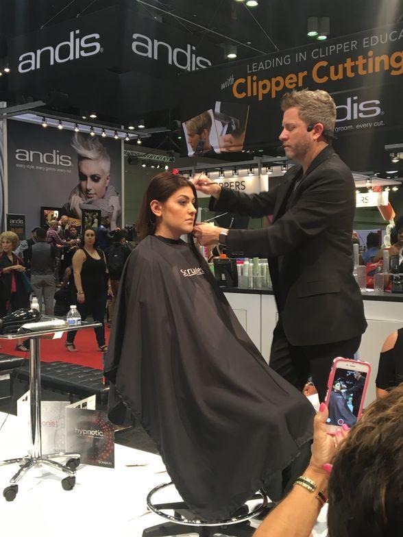 Chris Venesky of Scruples makes a model's hair dance onstage.