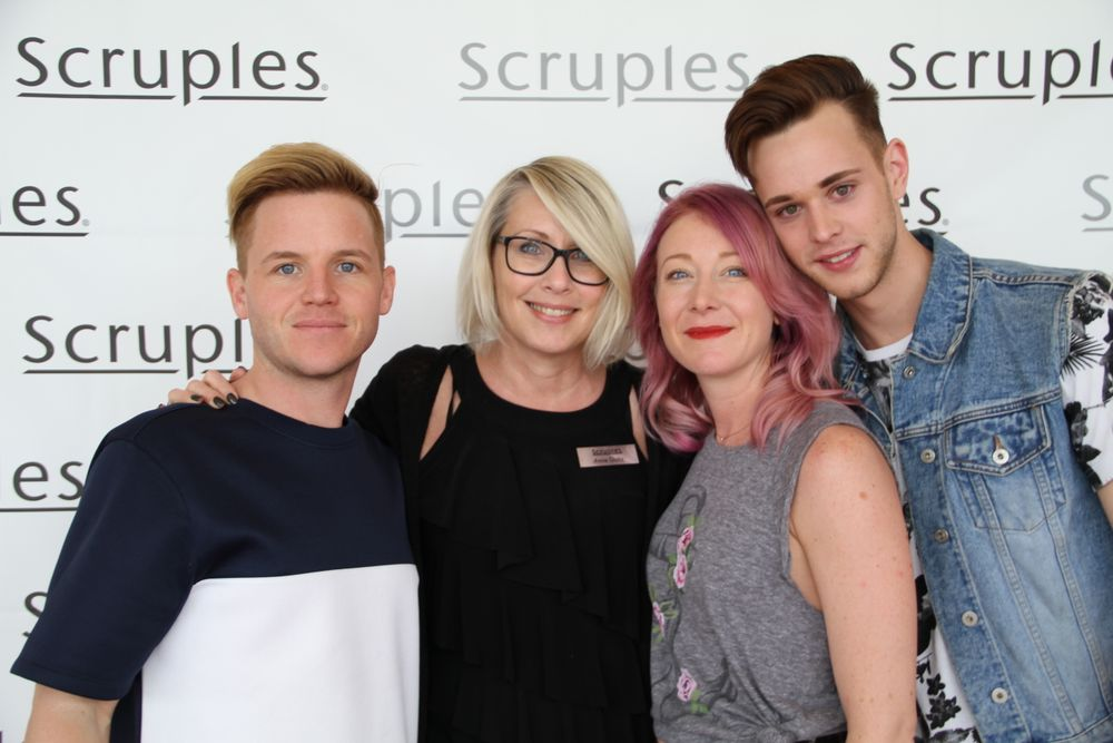 Goltz poses with Scruples Symposium attendees.