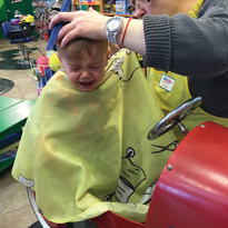 Haircuts can be scary--the number-one rule is distraction, distraction, distraction. (photo...
