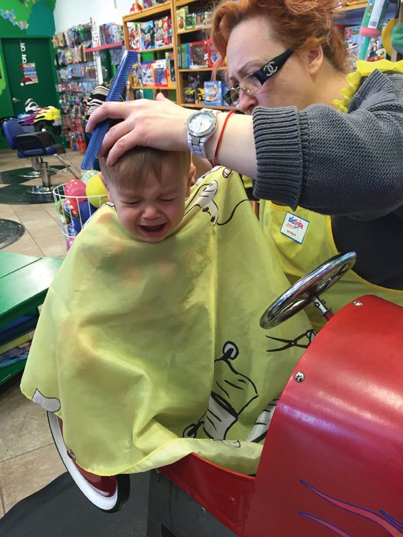 Haircuts can be scary--the number-one rule is distraction, distraction, distraction. (photo credit: Alison Alhamed) Alison Alhamed