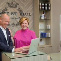 Rosy Software's Jim Bower demonstrates a new software feature to salon client Janet St. Paul at...