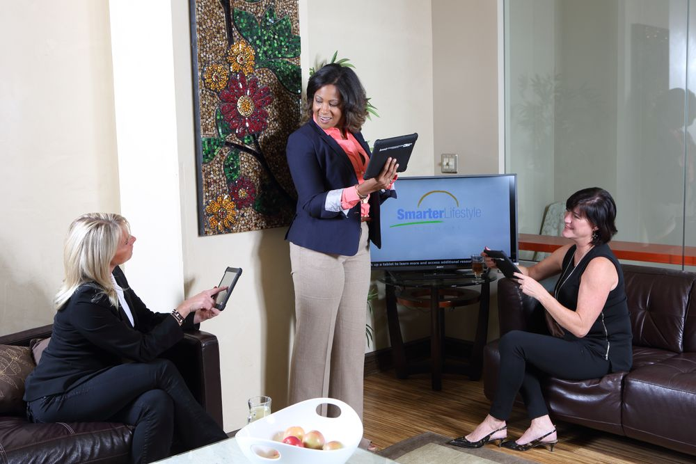 Clients are entertained and educated with beauty, fitness and lifestlye content on tablets and monitors stationed in the salon's reception and processing areas.