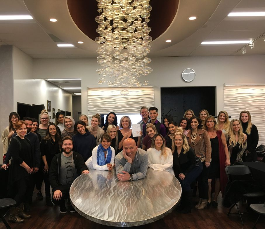 Jay Williams (center, leaning on table), Gayle Fulbright (behind Jay, pointing at the book) and the team from Headlines The Salon in Encinitas.