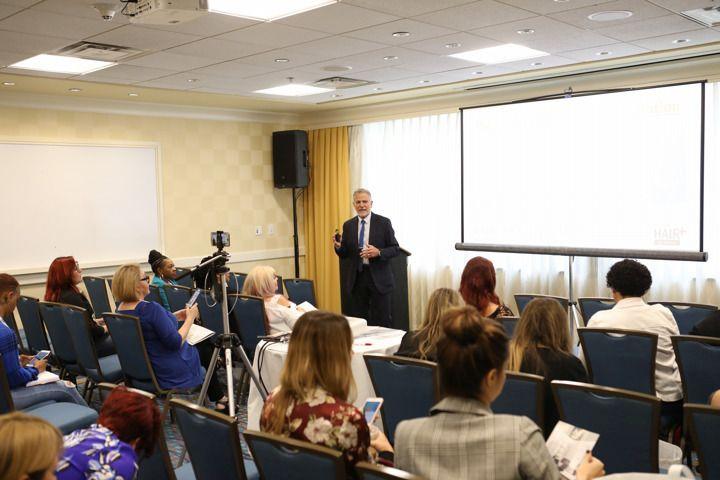 <p>Jeffrey Paul walks attendees through a hair loss consultation.</p>