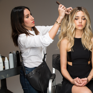 Jen Atkin on set using her Beauty Works collection line of hair extensions.