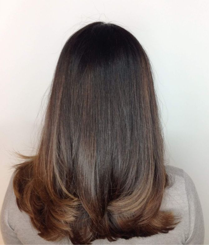 """<p>CREME BRÛLÉE: """"This is a natural level 4 and is 50% white. First, I used Majirel 3N and 4.3 equal parts withMajicrème Developer<a href=""""http://www.saloncentric.com/670281011028.html"""" target=""""_blank"""" rel=""""noopener noreferrer"""">20-Volume</a> on the regrowth. Once the base was on, I painted<a href=""""https://www.saloncentric.com/SCLP-MAJIREL-PermColor.html"""" target=""""_blank"""" rel=""""noopener noreferrer"""">Majirel French Brown</a> shade 6.025 through mid-lengths and ends on previously lightened hair to richen it up. Lastly, I glossed with DIA Light 7.8 and DIActivateur Developer<a href=""""http://www.saloncentric.com/884486079459.html"""" target=""""_blank"""" rel=""""noopener noreferrer"""">6-Volume</a> to complete the look.""""</p>"""