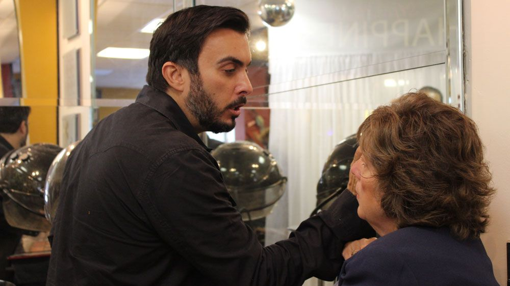 Emmy award-winning make-up artist, Jimmy DeMarco, applies make-up to a winner.