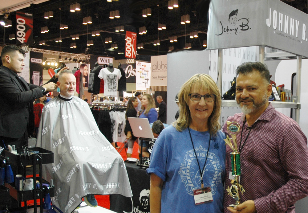 Alfonso Añorga is recognized by TASB founder, Elaine Lord, for his charitable contribution to autism Cut-A-Thon.