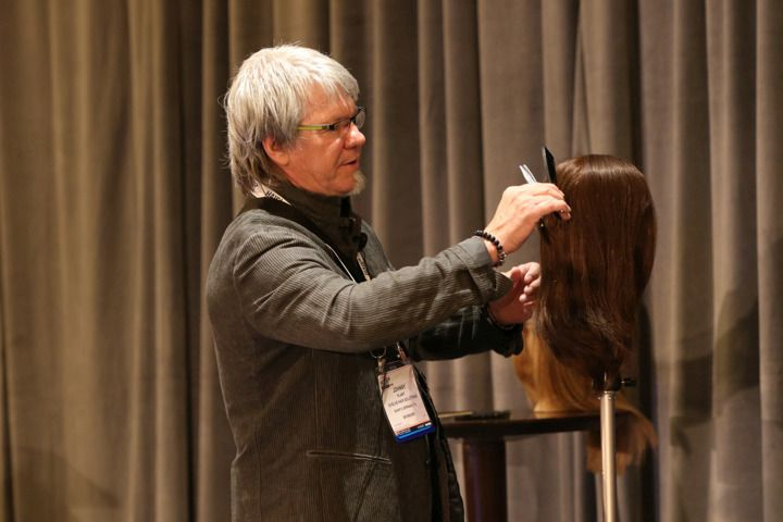 <p>Evolve&#39;s Johnny Plant demonstrates a haircut on a hair piece.</p>
