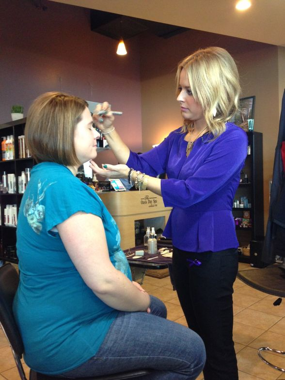 A stylist working on a client at Julia Grace on CUT IT OUT day.