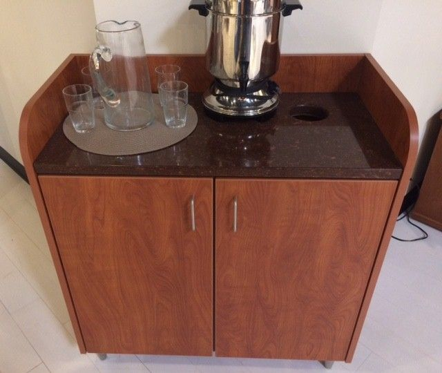 Bouras had just enough money left in her design budget to purchase this coffee station, which matches the new front desk.