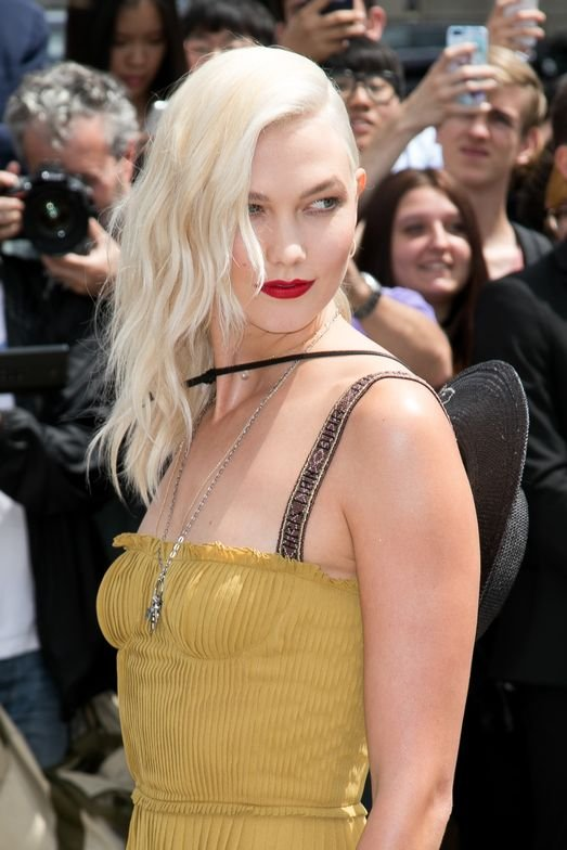 <p>Karlie Kloss debuted her light blonde color at the Christian Dior Couture show in Paris in July, as an internationally renowned model does.</p>
