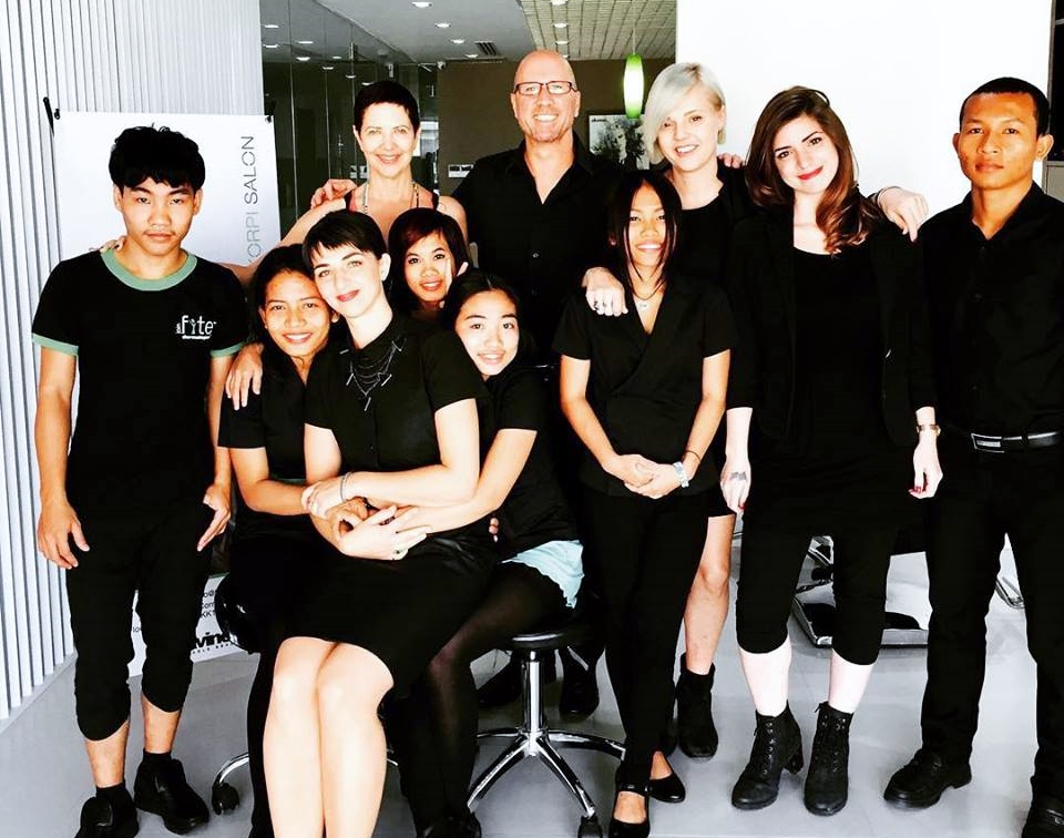 Matthew Fairfax with students and teachers at Kate Korpi Salon and Training Academy in Phnom Penh, Cambodia.