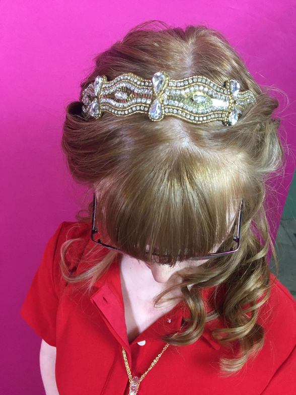 Kelly said she chose her Peggy hairband because it reminded her of a crown, and she wanted to feel like a princess. Kelly's hair was curled and pulled back to complement the hair piece.