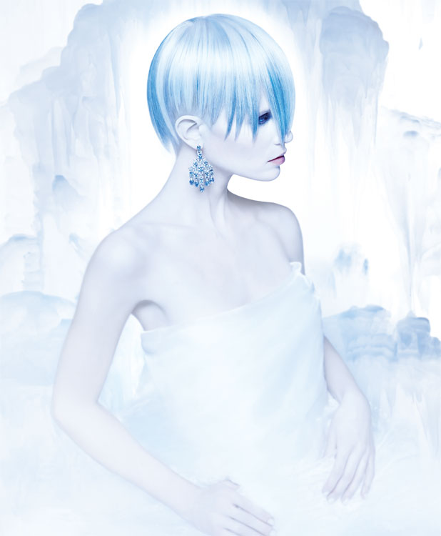 Pastel + Platinum -  A crown of platinum hair, pre-lightened with Power Blonde and toned with True Integrity Ash Toner, was sliced into deep points and amplified by streaks of Pastel Blue Urban Shock and Blue Urban Shock, paired with a closely cropped undercut. Stylers: White Tea Luminous Gel and Embrace Luxury Hold Hairspray
