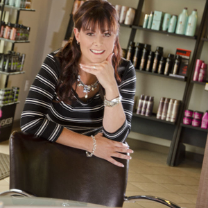 Kristi Valenzuela leads the Front Desk Division of the Summit Salons Business Center.  (photo...