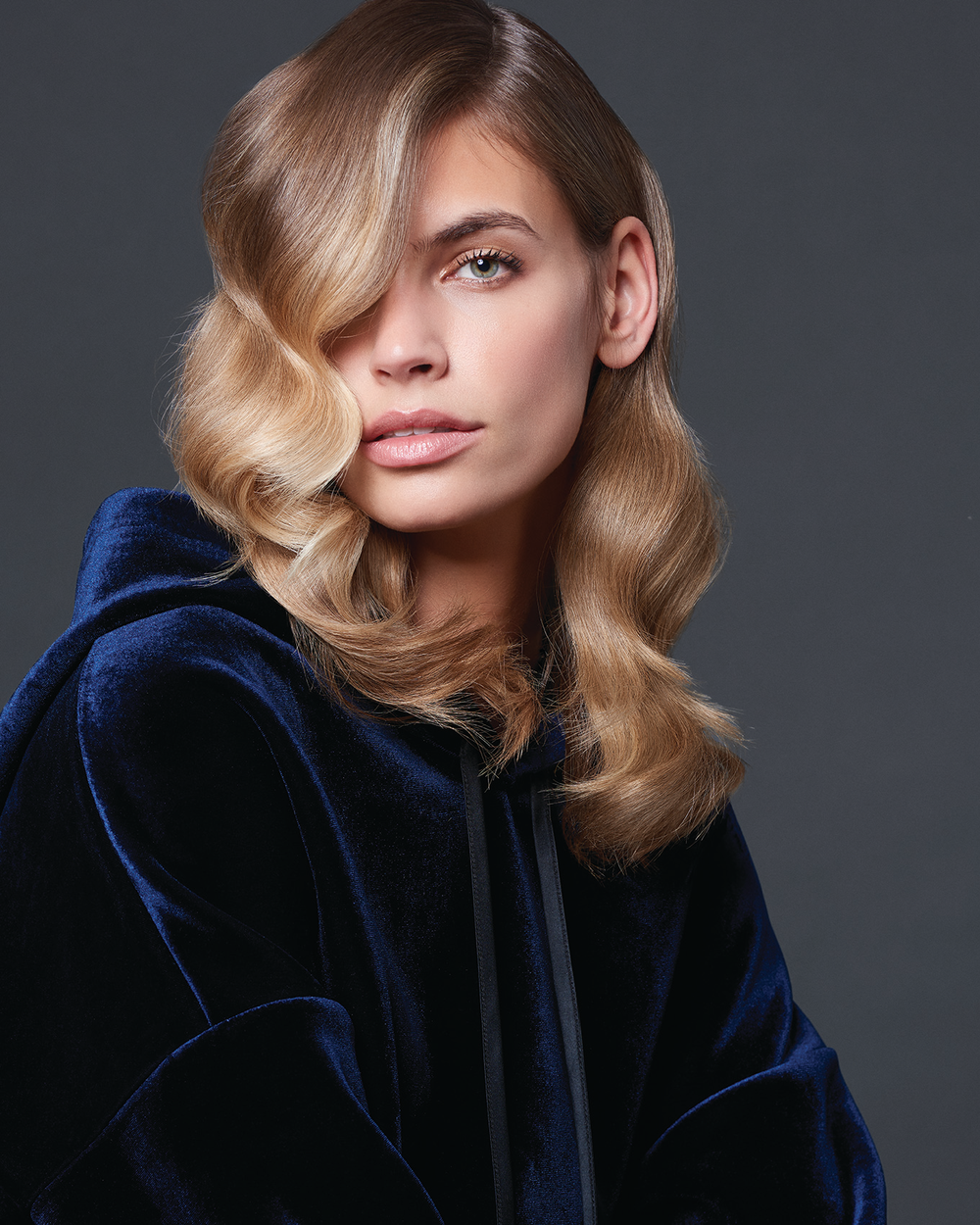 Balayage requires a shift in perception about what hair color should be--namely, filling in dark spaces and bringing bright pops of color to the ends.