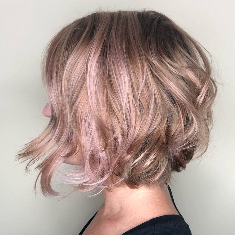 <p>Rose gold balayage highlights bring this textured bob up to a new level of chic.</p>