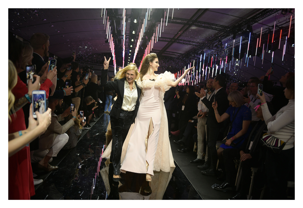 """Odile Gilbert takes a victory after an impressive fahion show in Paris celebrating L'<a href=""""https://www.lorealprofessionnel.com/"""" target=""""_blank"""" rel=""""noopener"""">Oréal Professionnel</a> , """"La French: Art Of Hair Coloring."""""""