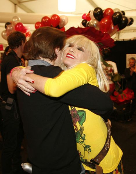 #13: Betsey made a beeline to hug  Peter after the show. She loved the hair. And him.