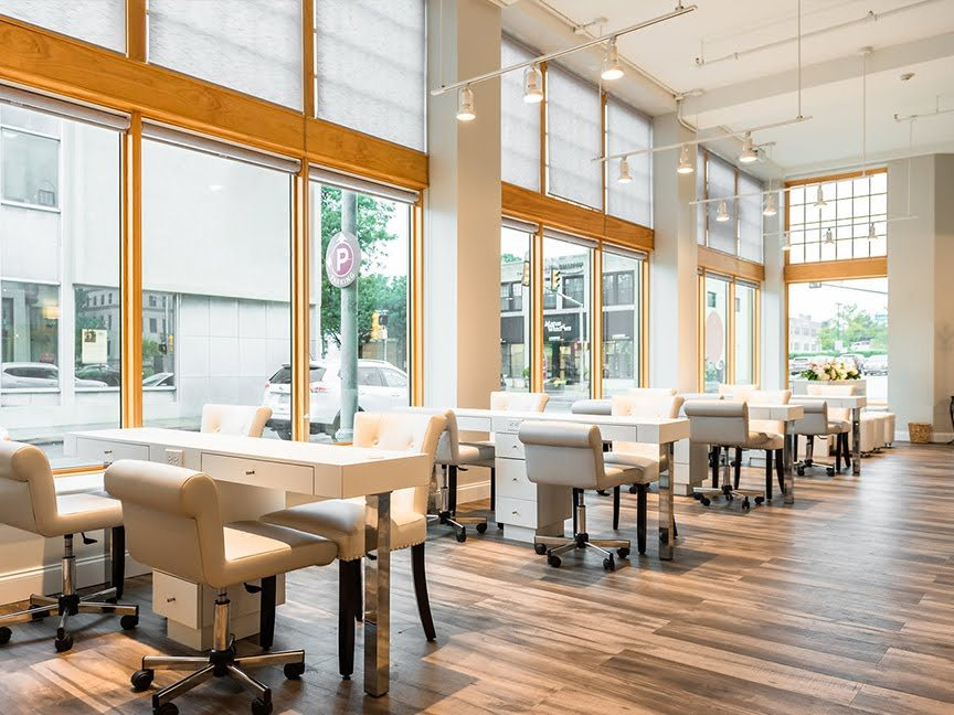 The storefront windows flood the space with an abundance of natural light.