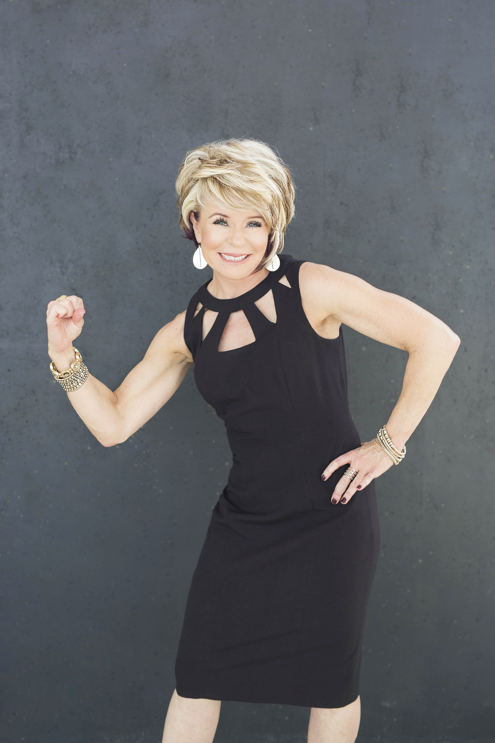 Laura Ortmann, owner of Ginger Bay Salons and Spas in Kirkwood, MO shows her strength.