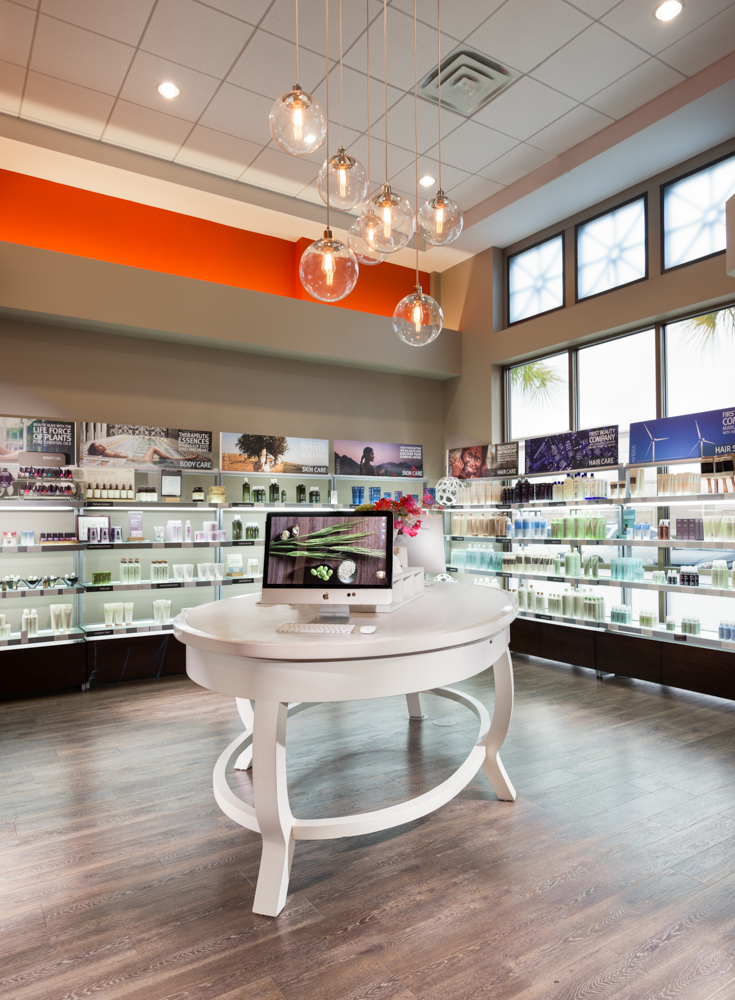 Instead of a front desk, Lavish owner Kristi Brehm modeled her reception area after an Apple store where a salon greeter welcomes the client and helps them check in.