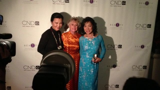 Kieu Chinh (left) and Tippi Hedren and one of the women who benefitted from Hedren's goodness.