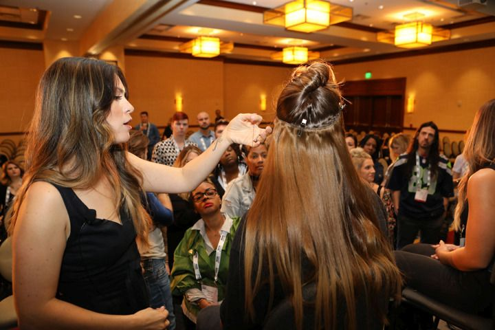 <p>Attendees get an up close look at Lindsay Guzman&#39;s extensions artistry.</p>