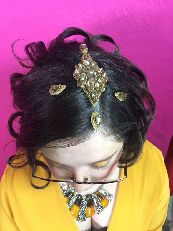 """Lindsey chose a bright yellow dress and Pink Pewter's bright yellow shadow, Party Girl. To go along with the gold and yellow theme of her look, Naomi gold-beaded jewels were added to her hair for extra flair. She also wore <a href=""""http://www.pinkpewter.com/Pink_Pewter_Collection_Addy_Choker_p/addychoker.htm?1=1&amp;CartID=0"""">Addy choker</a>in fuscia for an additional pop of color."""