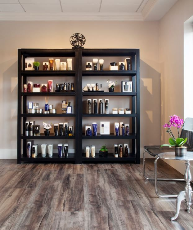 <p> Lola features black lacquer retail shelving for simplicity and to display products.</p>