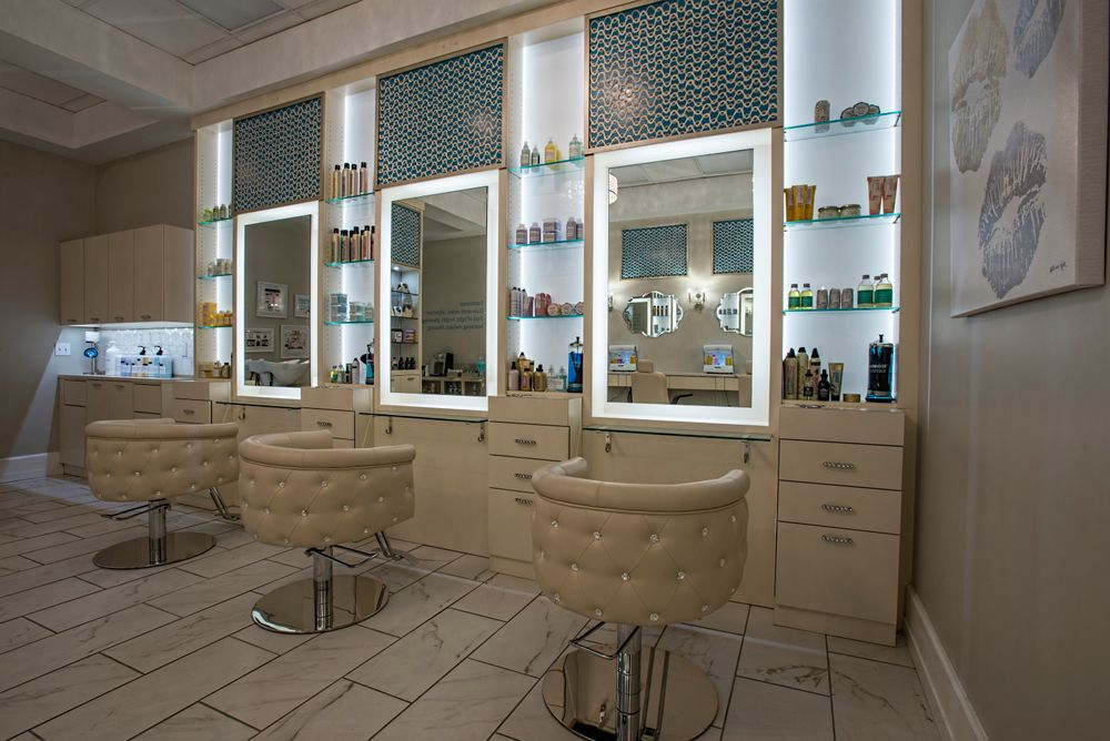 The custom built hair styling stations feature large mirrors with LED borders and the Obsession styling chair with genuine Swarovski Elements crystal accents. The crystal effect was carried to the styling stations by the use of crystal drawer pulls found and supplied by the owner.