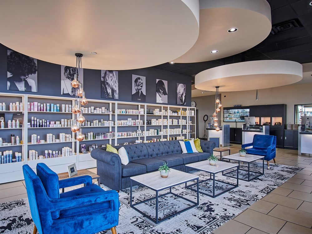 The bold blue velvet armchairs at Lux Haus Salon in Oklahoma City, are an inviting introduction to the space.