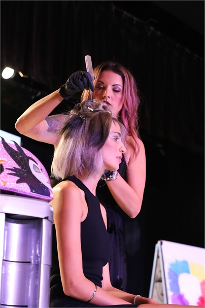 Leah Freeman on stage at L'anza's 2017 BIG Event.
