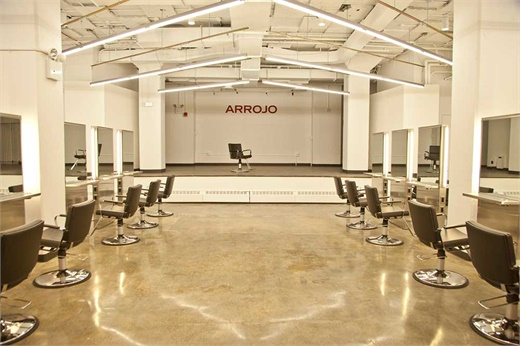 Arrojo Cosmetology School's clinic with mezzanine stage.