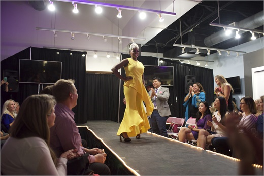 A model takes the stage at a fashion event hosted by Maude the Salon in at Centre Salon and Spa Arvada's fashion show.